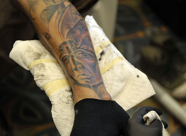 indian-tattoo is worked on during the 16th Annual Florida Tattoo Expo, at the Marriott Coral Springs Hotel-word-in-town