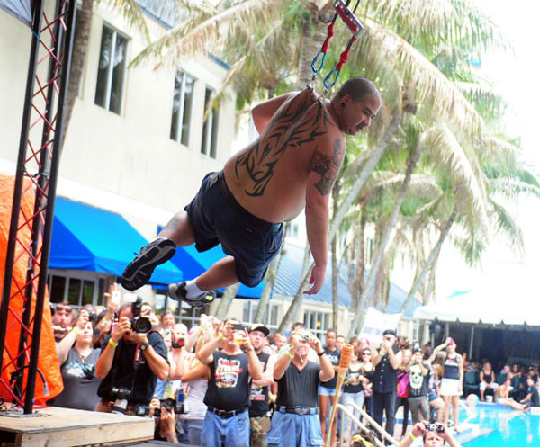 Chong-Skin-Madness-hangs-from-piercings-back-15th-Annual-South-Florida-Tattoo-Expo-word-in-town